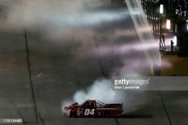 Cory Roper driver of the Ford spins during the NASCAR Gander Outdoors Truck Series NextEra Energy 250 at Daytona International Speedway on February...