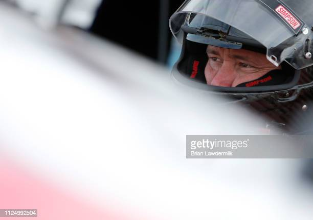 Cory Roper driver of the Ford stands in the garage area during practice for the NASCAR Gander Outdoor Truck Series NextEra Energy 250 at Daytona...