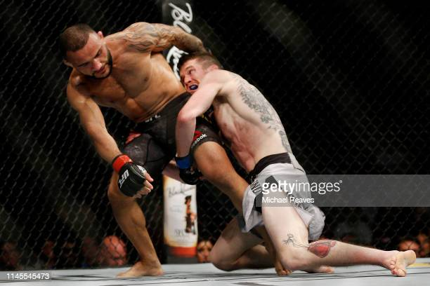 Cory Sandhagen and John Lineker of Brazil fight during their bantamweight bout at UFC Fight Night at BBT Center on April 27 2019 in Sunrise Florida