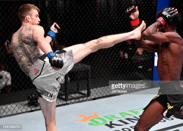 Cory Sandhagen kicks Aljamain Sterling in their bantamweight bout during the UFC 250 event at UFC APEX on June 06 2020 in Las Vegas Nevada