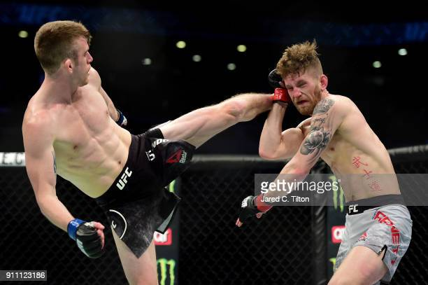 Cory Sandhagen kicks Austin Arnett in their welterweight bout during the UFC Fight Night event inside the Spectrum Center on January 27 2018 in...