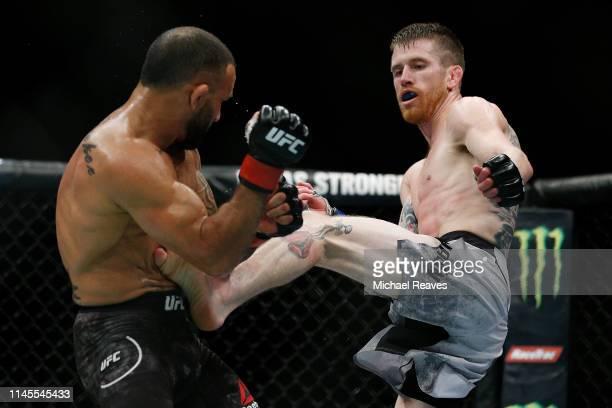 Cory Sandhagen kicks John Lineker of Brazil during their bantamweight bout at UFC Fight Night at BBT Center on April 27 2019 in Sunrise Florida