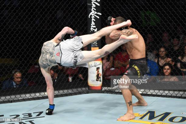 Cory Sandhagen kicks John Lineker of Brazil in their bantamweight bout during the UFC Fight Night event at BBT Center on April 27 2019 in Sunrise...