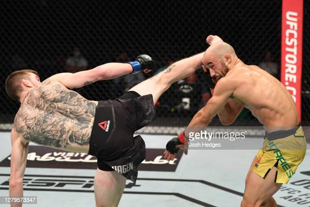Cory Sandhagen kicks Marlon Moraes of Brazil in their bantamweight bout during the UFC Fight Night event inside Flash Forum on UFC Fight Island on...