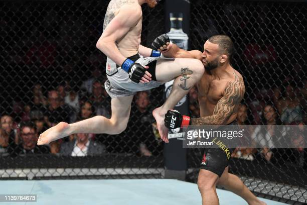 Cory Sandhagen knees John Lineker of Brazil in their bantamweight bout during the UFC Fight Night event at BBT Center on April 27 2019 in Sunrise...