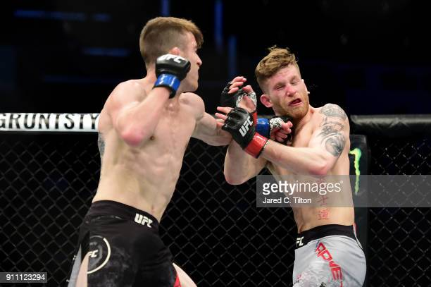 Cory Sandhagen punches Austin Arnett in their welterweight bout during the UFC Fight Night event inside the Spectrum Center on January 27 2018 in...