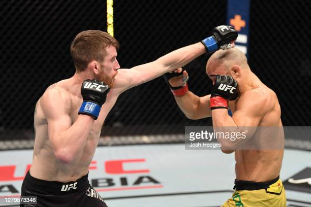 Cory Sandhagen punches Marlon Moraes of Brazil in their bantamweight bout during the UFC Fight Night event inside Flash Forum on UFC Fight Island on...