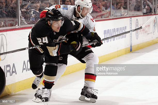Cory Sarich of the Calgary Flames battles for position against Evgeny Artyukhin of the Anaheim Ducks during the game on January 17 2010 at Honda...