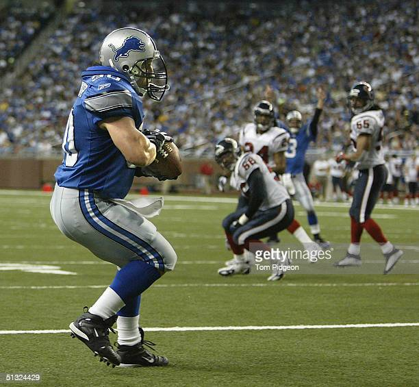 Cory Schlesinger of the Detroit Lions catches a touchdown pass in the second quarter against the Houston Texans at Ford Field on September 19, 2004...
