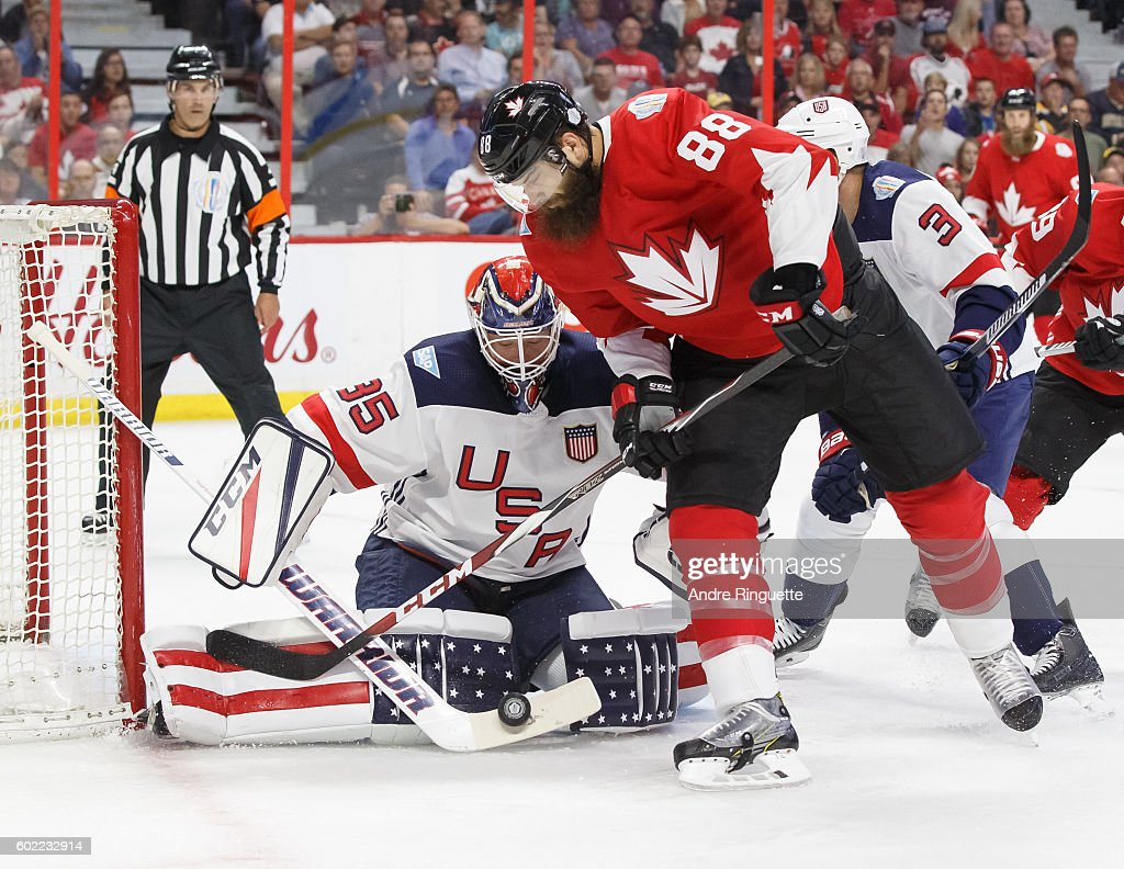 the best attitude 3ecc1 c2a13 Cory Schneider of Team USA makes a save as Brent Burns of ...