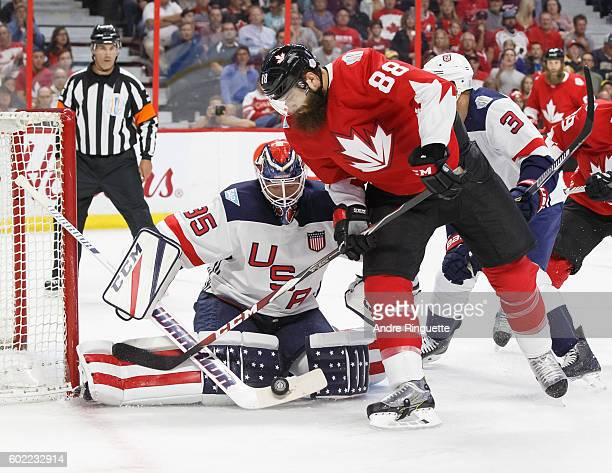Cory Schneider of Team USA makes a save as Brent Burns of Team Canada looks for a rebound during a World Cup of Hockey 2016 PreTournament game at...