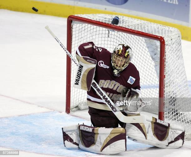 Cory Schneider of the Boston College Eagles stops a shot by the Wisconsin Badgers during the NCAA Men's Frozen Four Championship game on April 8,...