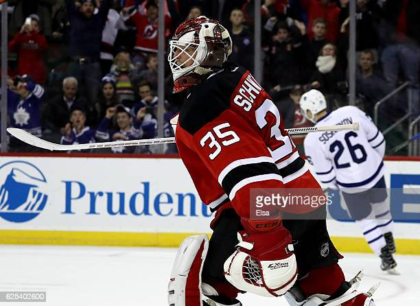 Cory Schneider of the New Jersey Devils celebrates the win after he stopped a shot by Nikita Soshnikov during a shootout on November 23 2016 at...