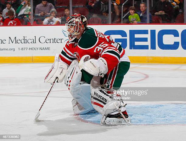 Cory Schneider of the New Jersey Devils defends his net against the Pittsburgh Penguins during the game at the Prudential Center on March 17 2015 in...