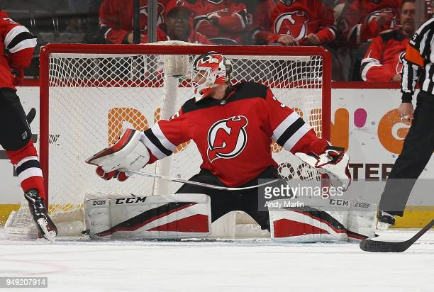 Cory Schneider of the New Jersey Devils defends his net in Game Four of the Eastern Conference First Round against the Tampa Bay Lightning during the...
