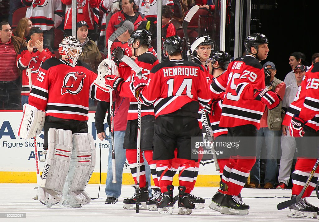 Cory Schneider #35 of the New Jersey Devils is congratulated after defeating the Toronto Maple Leafs at the Prudential Center on March 23, 2014 in Newark, New Jersey. The New Jersey Devils defeated the Toronto Maple Leafs 3-2.