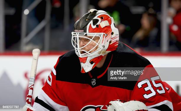 Cory Schneider of the New Jersey Devils looks on in Game Four of the Eastern Conference First Round against the Tampa Bay Lightning during the 2018...