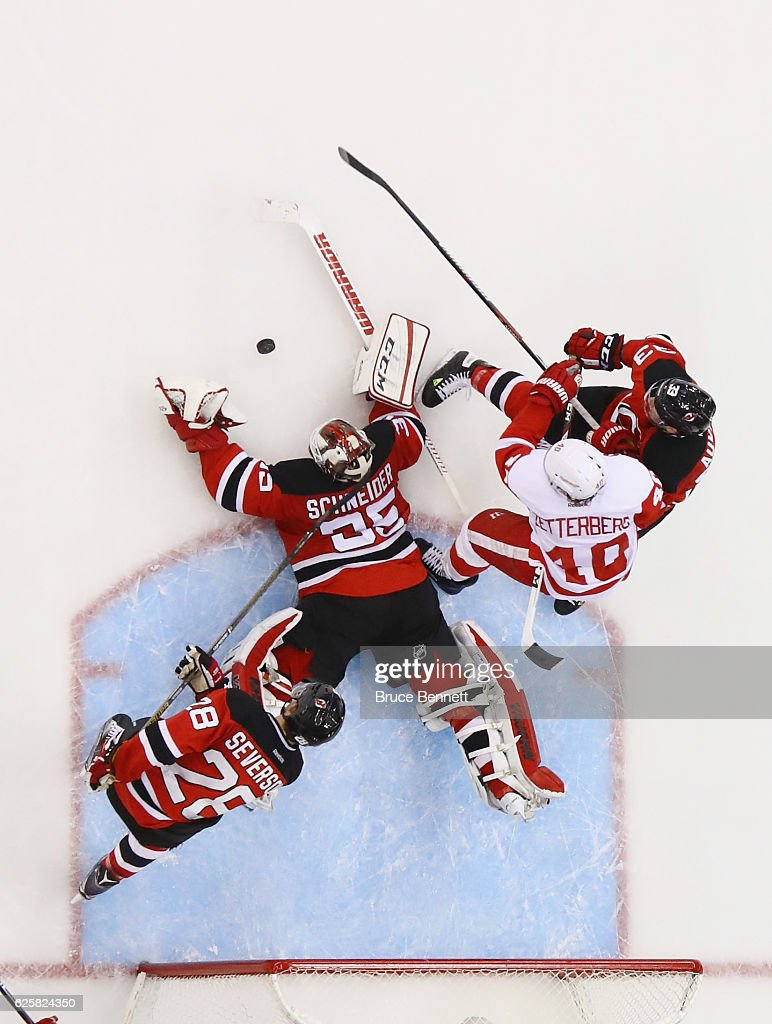 Cory Schneider #35 of the New Jersey Devils make sthe save against the Detroit Red Wings at the Prudential Center on November 25, 2016 in Newark, New Jersey. The Red Wings defeated the Devils 5-4 in overtime.