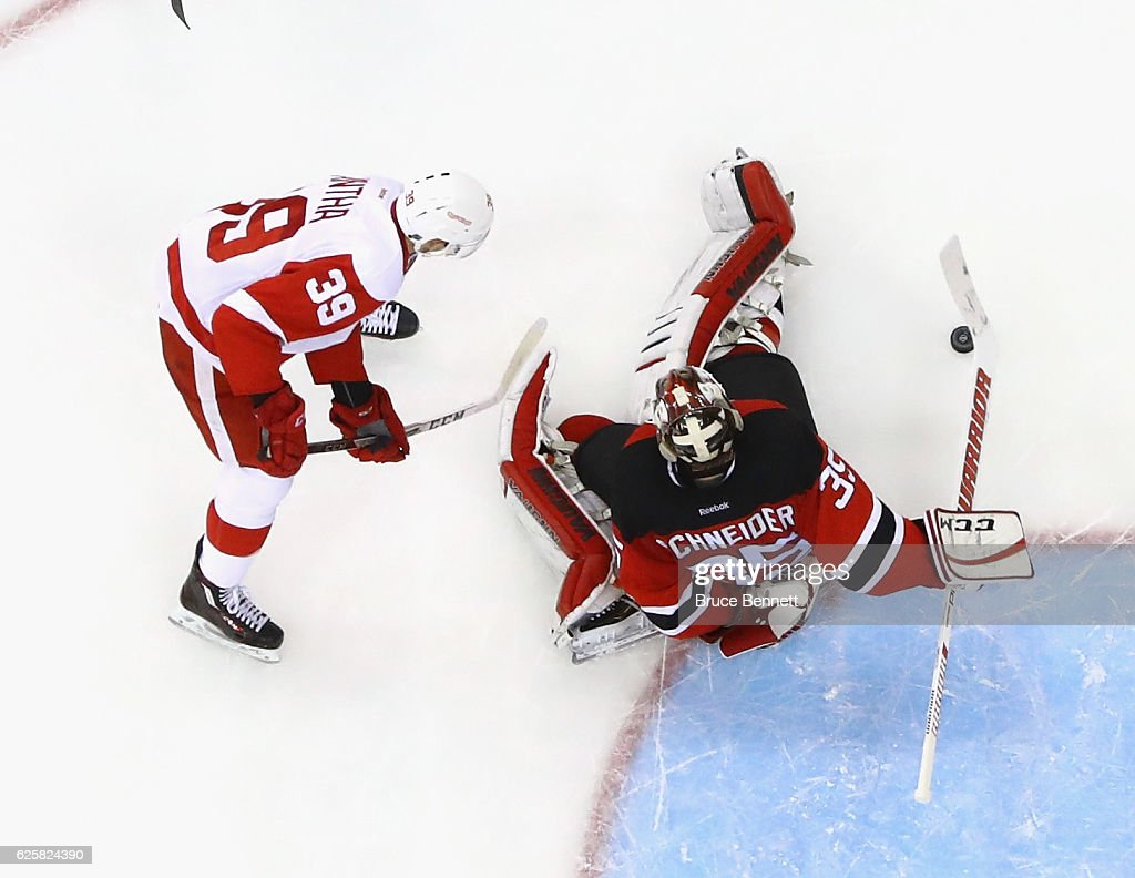 Cory Schneider #35 of the New Jersey Devils make sthe save on Anthony Mantha #39 of the Detroit Red Wings at the Prudential Center on November 25, 2016 in Newark, New Jersey. The Red Wings defeated the Devils 5-4 in overtime.