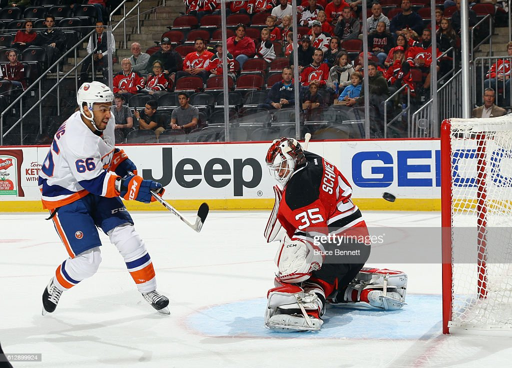 Cory Schneider #35 of the New Jersey Devils makes the first period save on Joshua Ho-Sang #66 of the New York Islanders at the Prudential Center on October 5, 2016 in Newark, New Jersey.