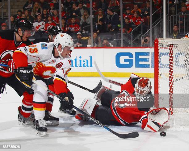 Cory Schneider of the New Jersey Devils makes the first period save on Sean Monahan of the Calgary Flames at the Prudential Center on February 3 2017...