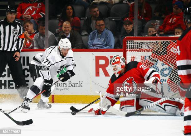 Cory Schneider of the New Jersey Devils makes the first period save on Torrey Mitchell of the Los Angeles Kings at the Prudential Center on December...