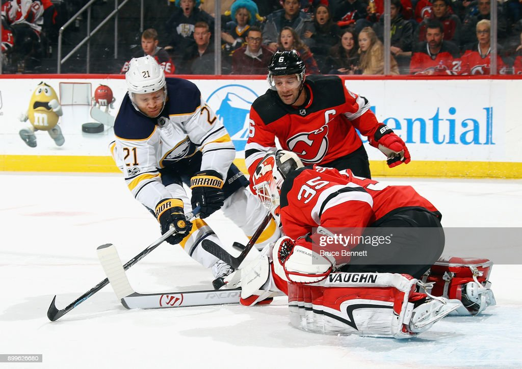Cory Schneider #35 of the New Jersey Devils makes the first period save on Kyle Okposo #21 of the Buffalo Sabres at the Prudential Center on December 29, 2017 in Newark, New Jersey.