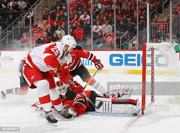 Cory Schneider of the New Jersey Devils makes the pad save on Steve Ott of the Detroit Red Wings during the first period at the Prudential Center on...