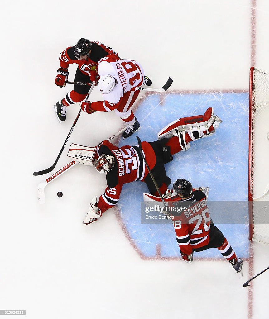 Cory Schneider #35 of the New Jersey Devils makes the save against the Detroit Red Wings at the Prudential Center on November 25, 2016 in Newark, New Jersey. The Red Wings defeated the Devils 5-4 in overtime.