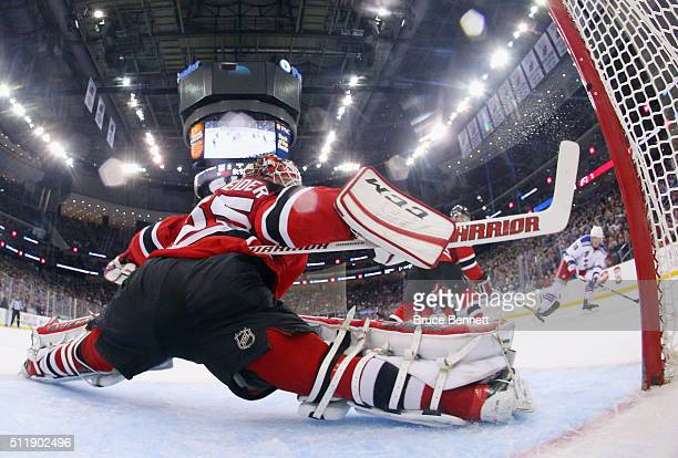 Cory Schneider of the New Jersey Devils makes the second period save on JT Miller of the New York Rangers at the Prudential Center on February 23...