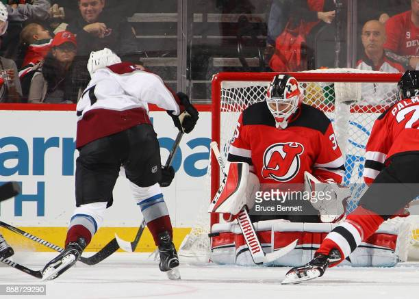 Cory Schneider of the New Jersey Devils makes the second period save on Tyson Jost of the Colorado Avalanche at the Prudential Center on October 7...