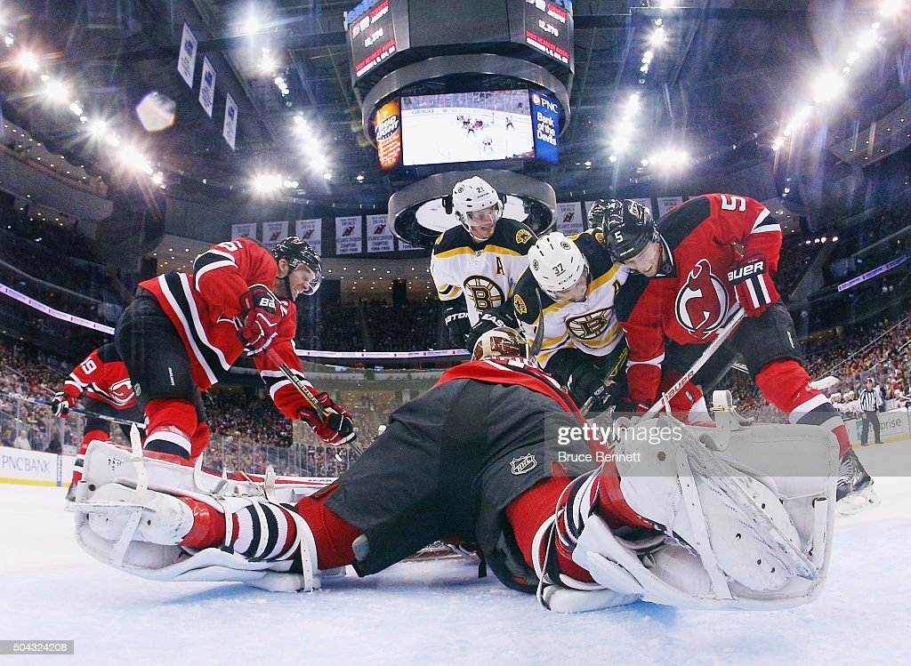 Cory Schneider #35 of the New Jersey Devils makes the stop against the Boston Bruins at the Prudential Center on January 8, 2016 in Newark, New Jersey. The Bruins defeated the Devils 4-1.