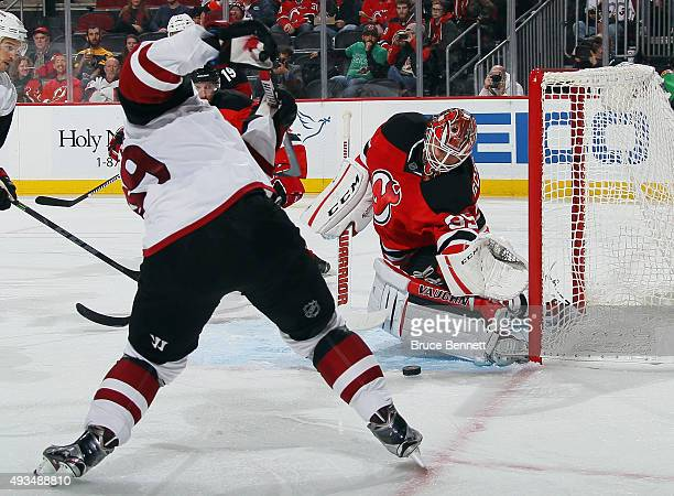 Cory Schneider of the New Jersey Devils makes the third period save against Mikkel Boedker of the Arizona Coyotes at the Prudential Center on October...
