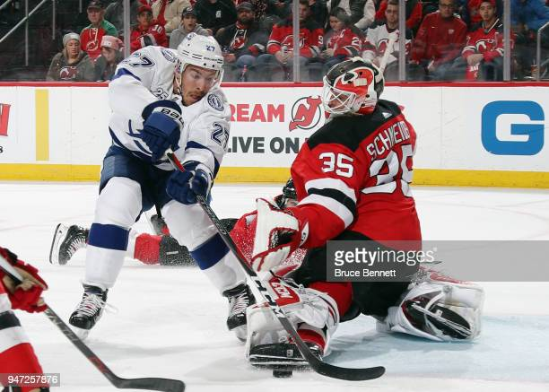 Cory Schneider of the New Jersey Devils makes the third period save on Ryan McDonagh of the Tampa Bay Lightning in Game Three of the Eastern...