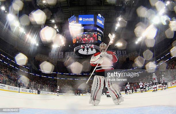 Cory Schneider of the New Jersey Devils returns to the net following a timeout during the game against the Ottawa Senators at the Prudential Center...