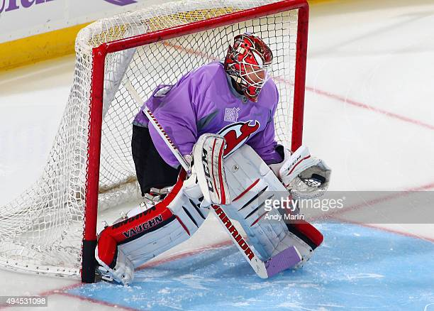 Cory Schneider of the New Jersey Devils skates during warmups wearing the lavander Hockey Fights Cancer Awareness Night jersey prior to the game...