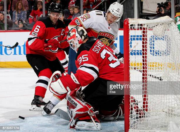 Cory Schneider of the New Jersey Devils stops a shot by Jonathan Huberdeau of the Florida Panthers in the third period on November 11 2017 at...