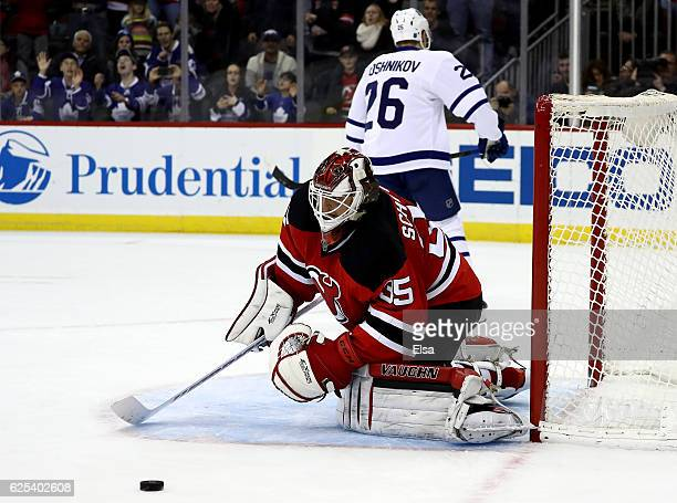 Cory Schneider of the New Jersey Devils stops a shot by Nikita Soshnikov during a shootout to win the game on November 23 2016 at Prudential Center...