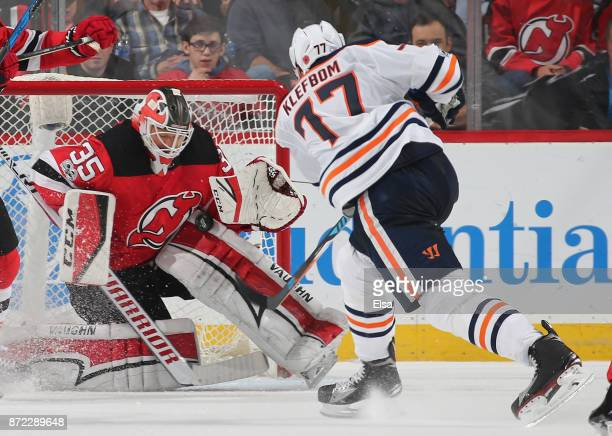 Cory Schneider of the New Jersey Devils stops a shot by Oscar Klefbom of the Edmonton Oilers in the second period on November 9 2017 at Prudential...