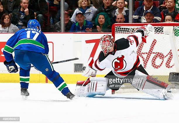 Cory Schneider of the New Jersey Devils stops Radim Vrbata of the Vancouver Canucks on a penalty shot during their NHL game at Rogers Arena November...