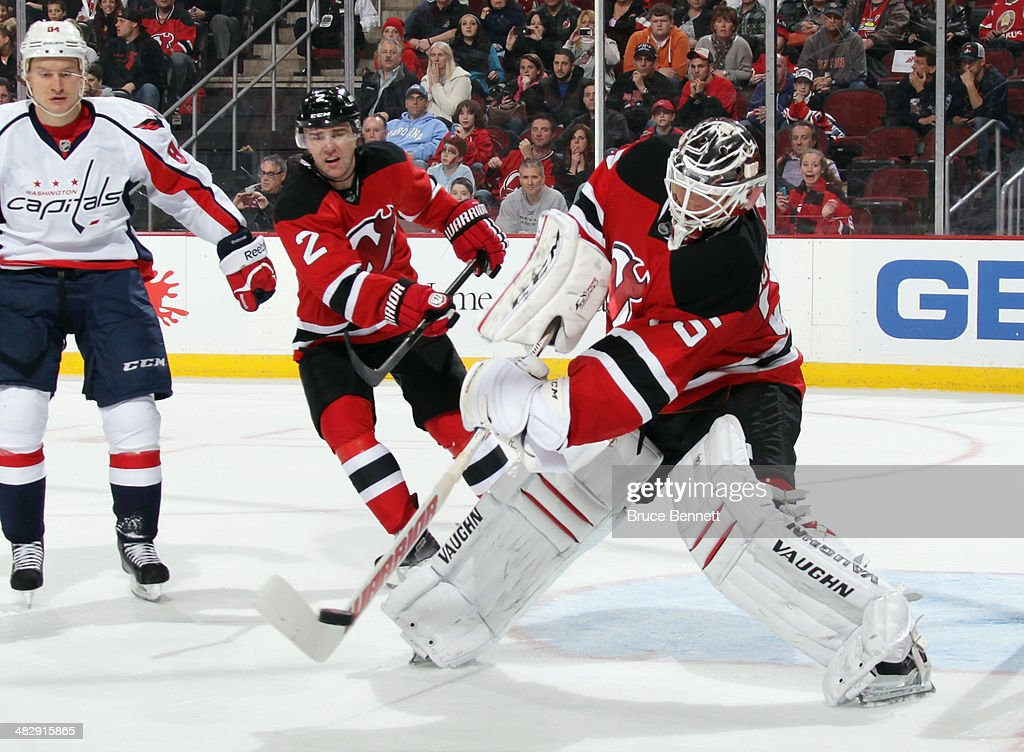 Cory Schneider #35 of the New Jersey Devils tends net against the Washington Capitals at the Prudential Center on April 4, 2014 in Newark, New Jersey. The Devils defeated the Capitals 2-1.