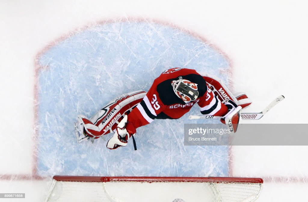 Cory Schneider #35 of the New Jersey Devils tends net against the Buffalo Sabres at the Prudential Center on December 29, 2017 in Newark, New Jersey. The Sabres defeated the Devils 4-3 in overtime.