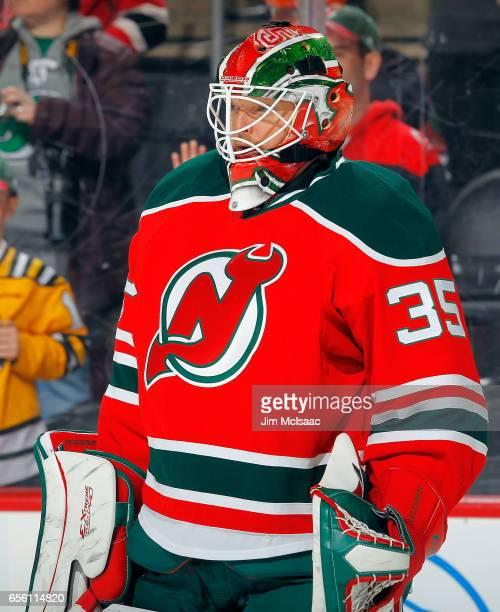 Cory Schneider of the New Jersey Devils warms up before a game against the Philadelphia Flyers on March 16 2017 at Prudential Center in Newark New...