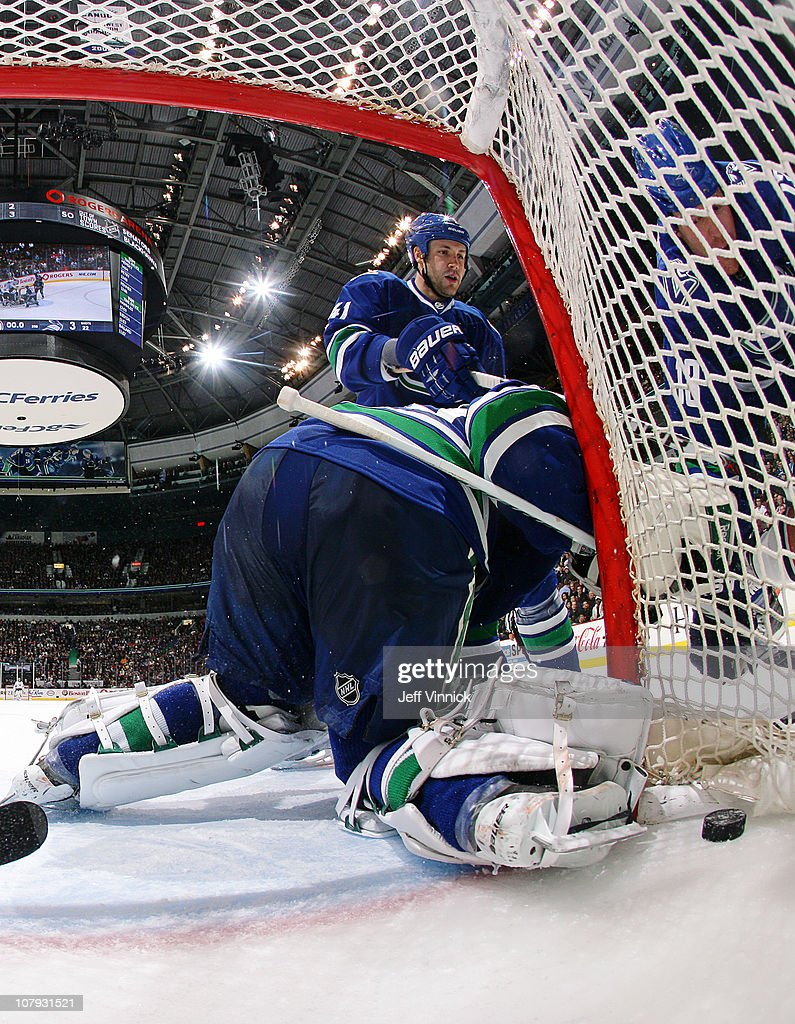 Cory Schneider #35 of the Vancouver Canucks gets scored on while teamates Andrew Alberts #41 and Raffi Torres #13 of the Vancouver Canucks look on during their game at Rogers Arena on January 7, 2011 in Vancouver, British Columbia, Canada.