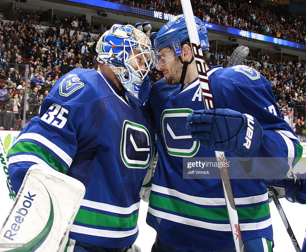 Cory Schneider #35 of the Vancouver Canucks is congratulated by teammate Ryan Kesler #17 after their 6-1 win over the Edmonton Oilers at Rogers Arena on January 7, 2011 in Vancouver, British Columbia, Canada.