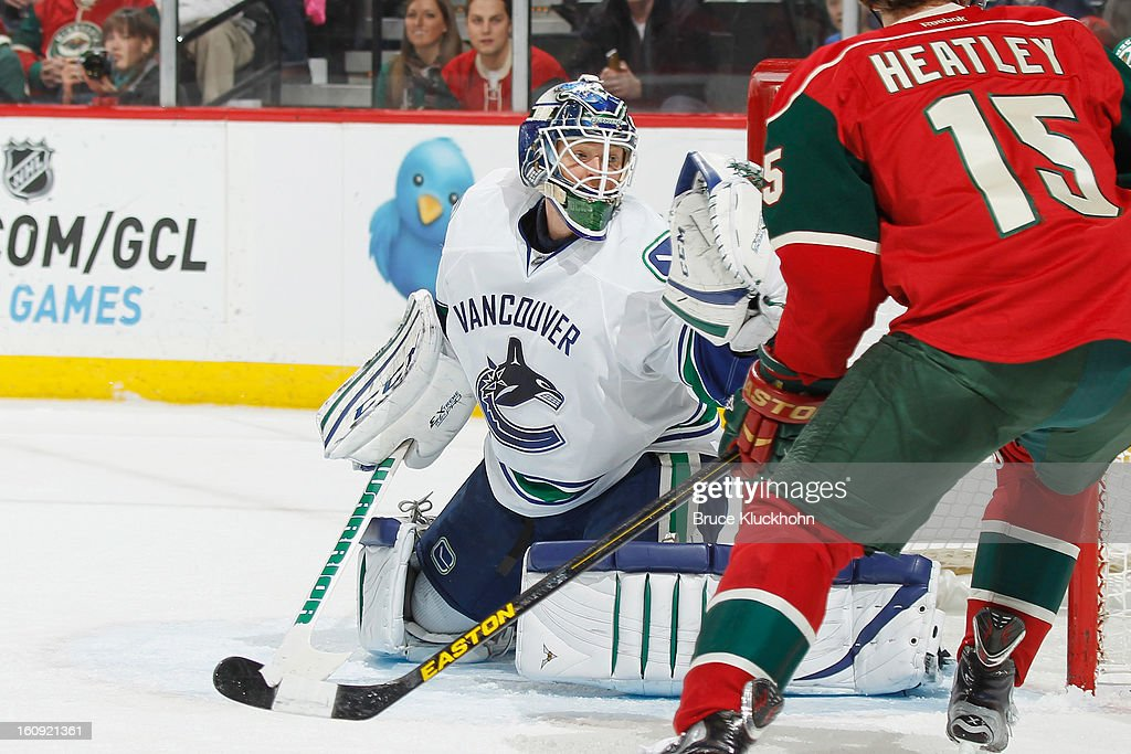 Cory Schneider #35 of the Vancouver Canucks makes a glove save against the Minnesota Wild during the game on February 7, 2013 at the Xcel Energy Center in St. Paul, Minnesota.
