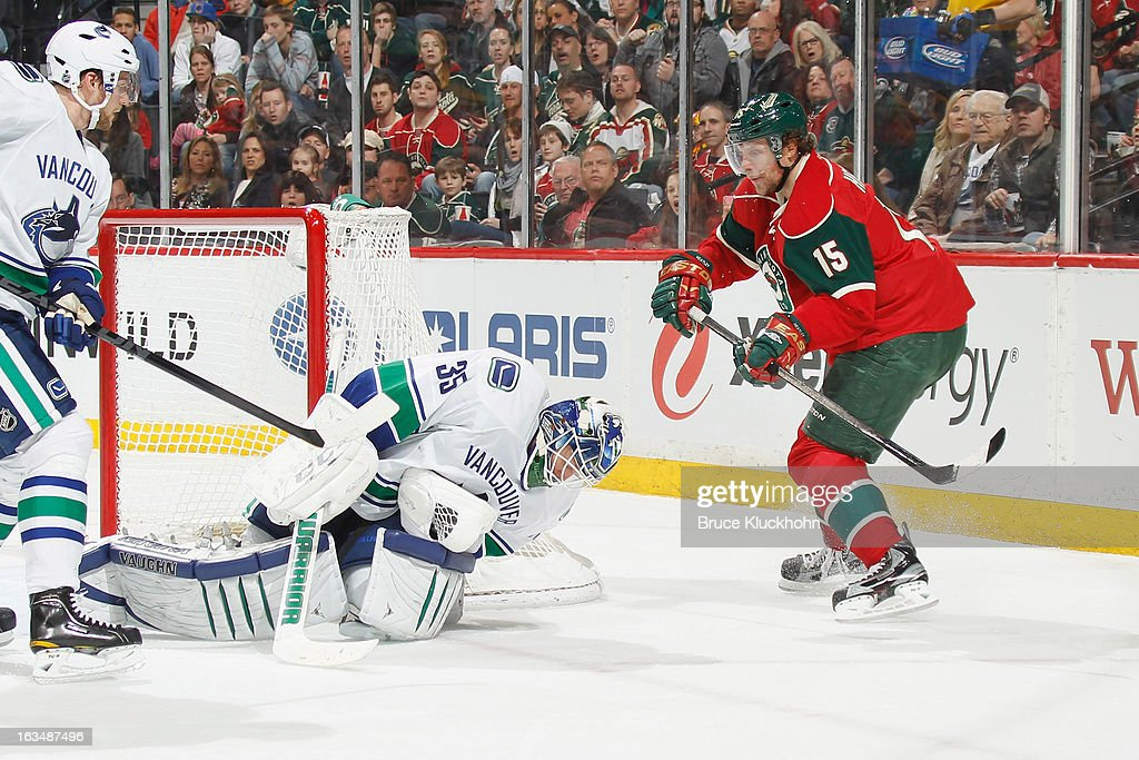 Cory Schneider #35 of the Vancouver Canucks makes a save with Dany Heatley #15 of the Minnesota Wild close by during the game on March 10, 2013 at the Xcel Energy Center in Saint Paul, Minnesota.