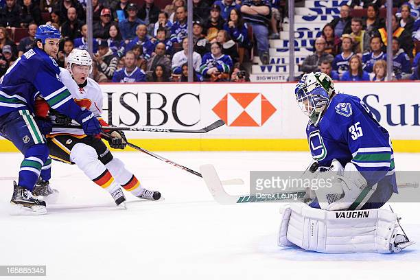 Cory Schneider of the Vancouver Canucks stops the shot of Alex Tanguay of the Calgary Flames during an NHL game at Rogers Arena on April 6 2013 in...
