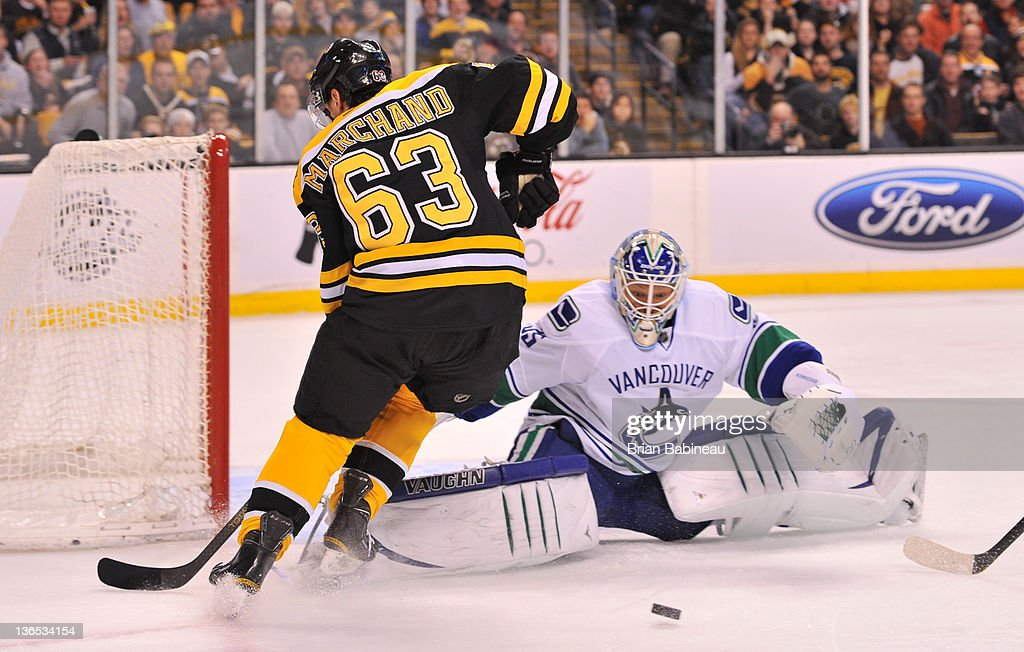 Cory Schneider #35 of the Vancouver Canucks watches the loose the puck against Brad Marchand #63 of the Boston Bruins at the TD Garden on January 7, 2012 in Boston, Massachusetts.