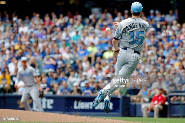 Cory Spangenberg of the San Diego Padres commits a throwing error as he throws to first base on a ball hit by Eric Sogard of the Milwaukee Brewers...